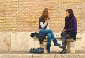 Two friends talking - improve your communication skills