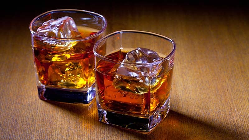 two glasses of bourbon alcohol