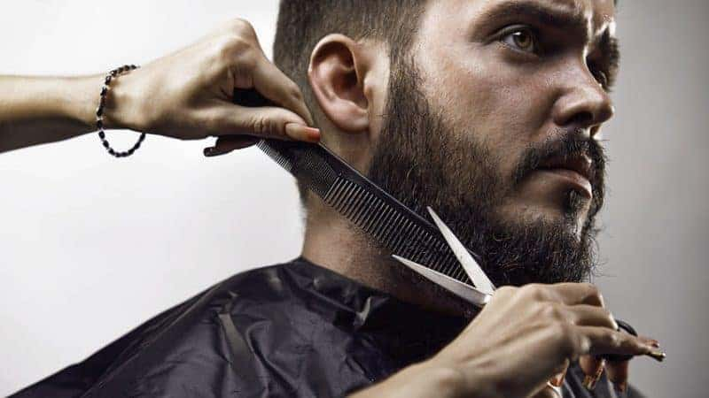 Trimming a beard with scissors